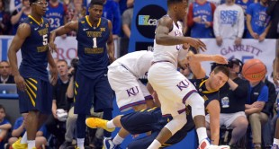 Nathan Adrian collides with a Kansas player during Tuesday night's gam.