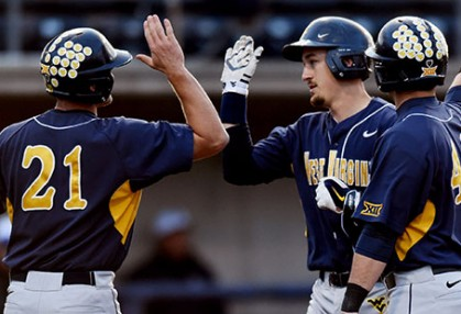 Ray Guerrini earns high-fives after his three-run homer put West Virginia ahead in a 4-1 win at Pitt on Tuesday night.