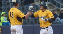 Taylor Munden crosses the plate after his ninth homer of the season during the Mountaineers' 3-2 win Tuesday night.