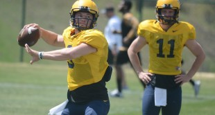 West Virginia quarterback Skyler Howard (3) goes through passing drills before Saturday's scrimmage at the Greenbrier.
