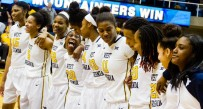 The West Virginia women sing 'Country Roads' after Wednesday night's 66-58 overtime victory against Temple.
