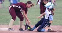 Wheeling Central shortstop Sydney Bennington tags out a Pendleton County runner during the Maroon Knights' win in the Class A softball state tournament on Wednesday.