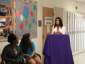 DHHR Cabinet Secretary Karen L. Bowling stressing the importance of immunizations while students Carmen Hall (far left) Ashley VanBrocklin listen.