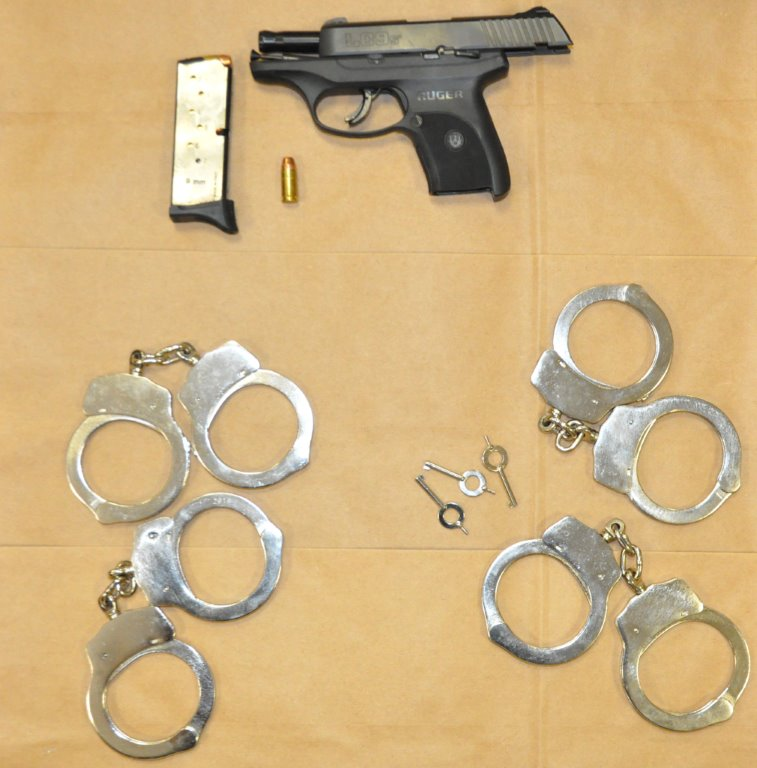 4 sets of handcuffs and a gun were among the recovered evidence.