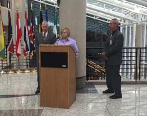 Judy Shepard speaks at the FBI complex in Harrison County with Dennis Shepard (L) and Albany County, Wyoming Sheriff David O'Malley (R)
