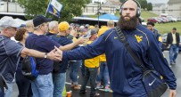 West Virginia punter Nick O'Toole enters the stadium Saturday afternoon during the Mantrip.