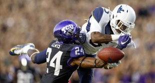 TCU Horned Frogs cornerback Julius Lewis (24) breaks up a pass intended for West Virginia Mountaineers wide receiver Jovon Durante (5) during the first quarter at Amon G. Carter Stadium.