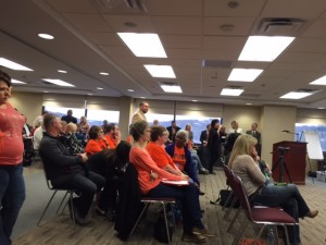 Fayette County residents in orange to support the proposal during Monday's meeting.