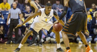 West Virginia forward Jonathan Holton guards Oklahoma State's Leyton Hammonds (23) during Saturday's game at the WVU Coliseum.