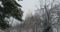 On Friday morning, heavy snow was falling at the West Virginia State Capitol where the state response to Winter Storm Jonas was being coordinated.