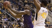 West Virginia forward Devin Williams defends a layup by TCU forward Chris Washburn during the Mountaineers' 73-42 win over TCU on Saturday at the WVU Coliseum in Morgantown, W.Va.