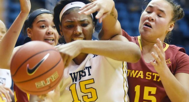Lanay Montgomery battles for a rebound against Iowa State.