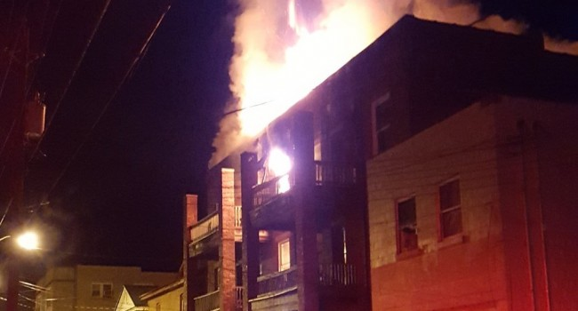 Fire rages on the top floor of a Logan apartment building