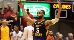 Jaysean Paige's 23 points helped lift No. 14 West Virginia to an 81-76 win at No. 13 Iowa State.