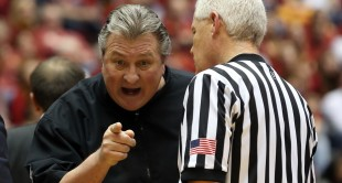 Feb 2, 2016; Ames, IA, USA; West Virginia Mountaineers head coach Bob Huggins talks to the official against the Iowa State Cyclones at James H. Hilton Coliseum. West Virginia Mountaineers beat the Iowa State Cyclones 81-76.  Mandatory Credit: Reese Strickland-USA TODAY Sports