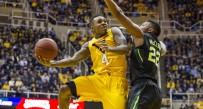 Daxter Miles scored 20 points on 4-of-5 shooting from 3-point range as West Virginia whipped Baylor 80-69 on Saturday night.