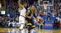 West Virginia Mountaineers guard Jevon Carter (2) dribbles the ball as Kansas Jayhawks guard Frank Mason III (0) defends in the first half at Allen Fieldhouse.