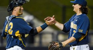 Pitcher Chad Donato and catcher Ray Guerrini celebrate Friday night's complete-game two-hitter in a 10-0 win over Baylor.