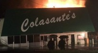 Flames leap from the rear of the building at the well known Colasante's in Westover