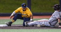 West Virginia third baseman Ivan Vera applies the game-ending tag to a Virginia Tech baserunner during the Mountaineers' 5-4 win on Tuesday.