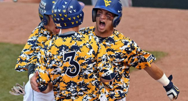 KC Huth celebrates a run during Thursday's 9-4 win over Texas Tech at the Big 12 tournament.
