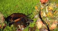 Ross Meelinger of Ravenswood, W.Va. admires his big gobbler.