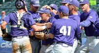 TCU players mob closer Durbin Feltman after Sunday's Big 12 tournament championship. TCU won 11-10 in 10 innings.