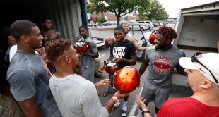 A look at Alabama football players helping load equipment donations onto a truck for West Virginia high school teams affected by flooding this summer.
