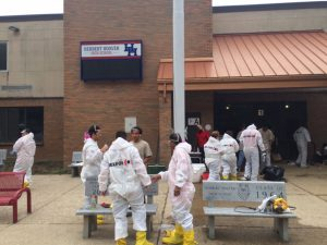 A professional cleaning team worked last month to rid the old Herbert Hoover High School building of mud and ruined furniture.