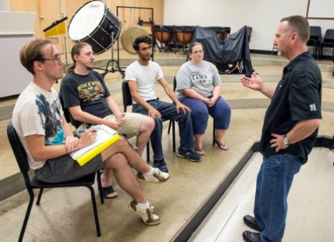 "Dr. Scott Woodard meets with student volunteers at WVSU to discuss plans for the ""Orchestra of the Hills"" benefit performance."
