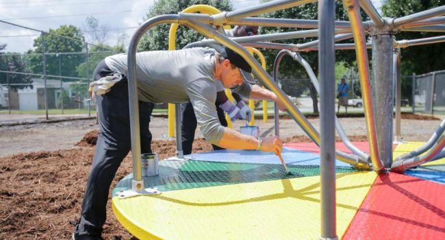Wednesday's work included repainting playground equipment.