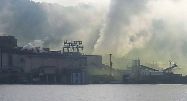 A yellow cloud is seen Saturday morning rising from the plant from the Ohio side of the river