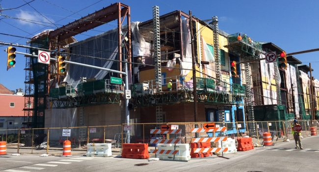 Work to replace the brick has encased the PSC headquarters in Charleston in scaffolding