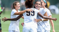 West Virginia celebrates a 3-1 win over Saint Francis, bolstered by two goals from Sh'Nia Gordon (99).