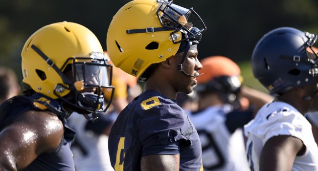 West Virginia safety Kyzir White watches during Tuesday's first preseason practice.
