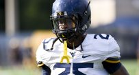 Junior college transfer Justin Crawford is contributing to a talented mix of running backs at West Virginia.