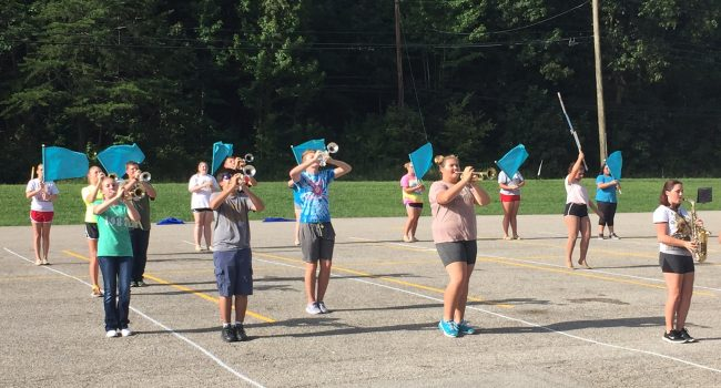 Hoover students have been rehearsing on the Elkview Middle School parking lot where they attend school on a split schedule.