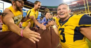 Skyler Howard completed 31-of-40 passes for 332 yards and accounted for two touchdowns as West Virginia beat BYU 35-32.