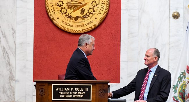 Senate President Bill Cole shakes hands with Minority Leader Jeff Kessler at the end of interims in September. Both positions are up for grabs.