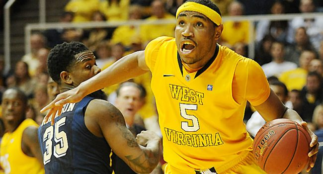 West Virginia's Kevin Jones drives against Pitt during a 2012 game at the WVU Coliseum, the last season the teams resided in the Big East.