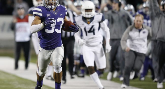 Kansas State defensive back Morgan Burns (33) races for the goal line on a 97-yard kick off return for the go-ahead touchdown against West Virginia on Saturday, Dec. 5, 2015, at Bill Snyder Family Stadium in Manhattan, Kan. The host Wildcats won, 24-23.