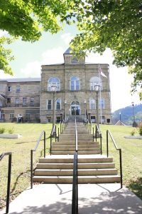 Positions and services already have been cut at the Webster County Courthouse, but now the county must tighten its belt some more to pay off its jail bill.