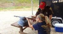 Children get a chance to shoot all weekend on the range run by the DNR's Natural Resources Police