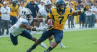 Rushel Shell scored two first-half touchdowns for West Virginia.