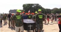 Miners carried a casket at September rally in Washington  as a symbol of the potential loss of health care benefits without action in Congress