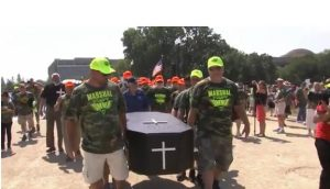 Miners carried a casket at last weeks rallyl as a symbol of the potential loss of health care benefits without action in Congress