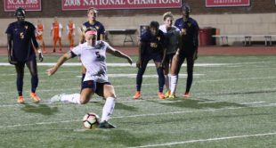 Richmond's Meaghan Carrigan scored on a second-half penalty kick but No. 4 West Virginia rolled to a 4-1 victory.