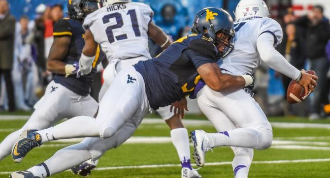 West Virginia Noble Nwachukwu sacks TCU's Kenny Hill inches away from the goal line.