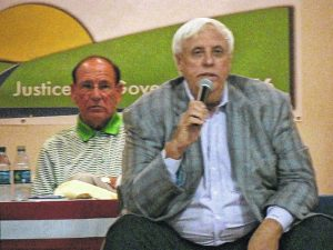 With former Marshall football Coach Bob Pruett behind him, Jim Justice addresses a crowd in Mason County.