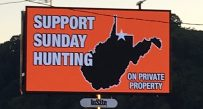 A billboard in Monongalia County encourages a yes vote for Sunday hunting in November